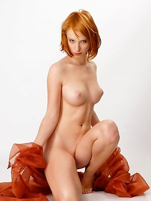 Redhead Clelia displays her creamy