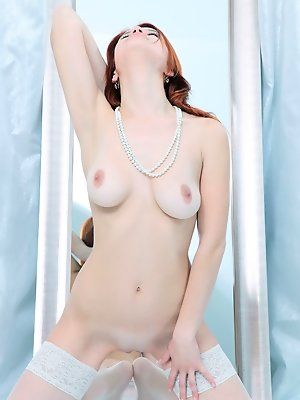 Redhead Violla A flaunts her curvy body by the mirror.