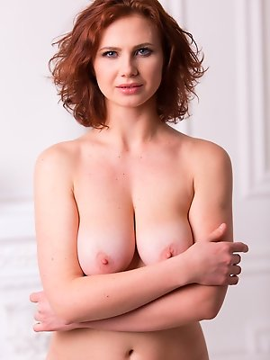 Aphrodita bares her beautiful tits and meaty ass in front of the camera.